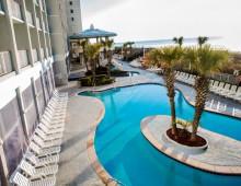 Crown Reef Pool Deck and Palm Trees