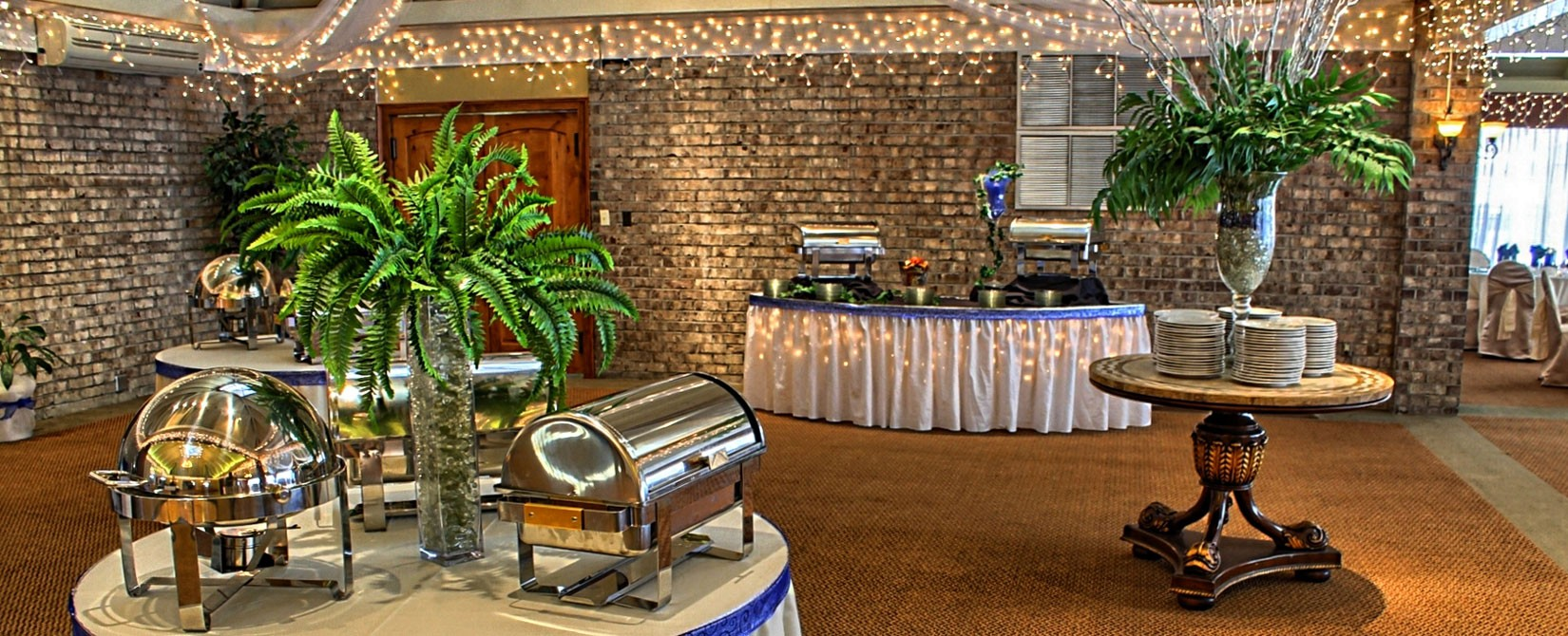 Banquet room at Caravelle Resort set up with plates and silver chafing dishes