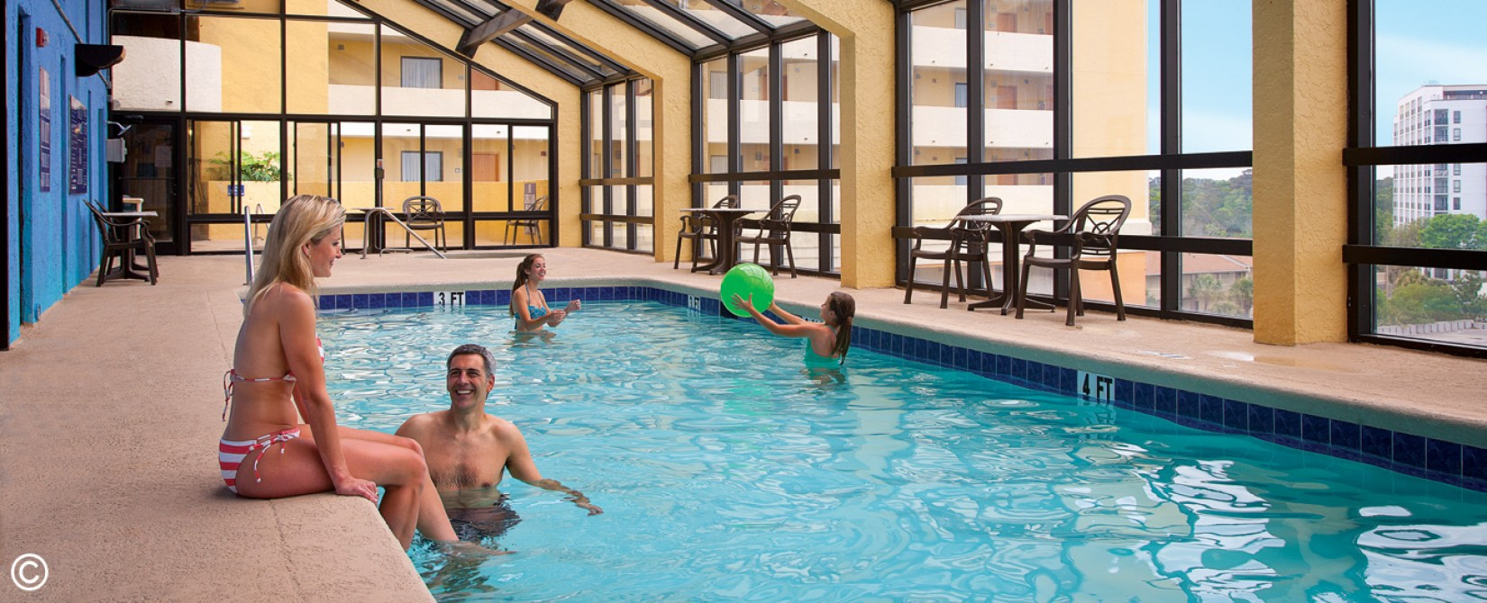 Family enjoying an indoor Myrtle Beach swimming pool.