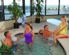 Group of vacationers enjoying the indoor hot tub at Palace Resort in Myrtle Beach