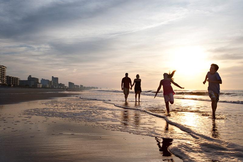 kids running along the beach in myrtle beach