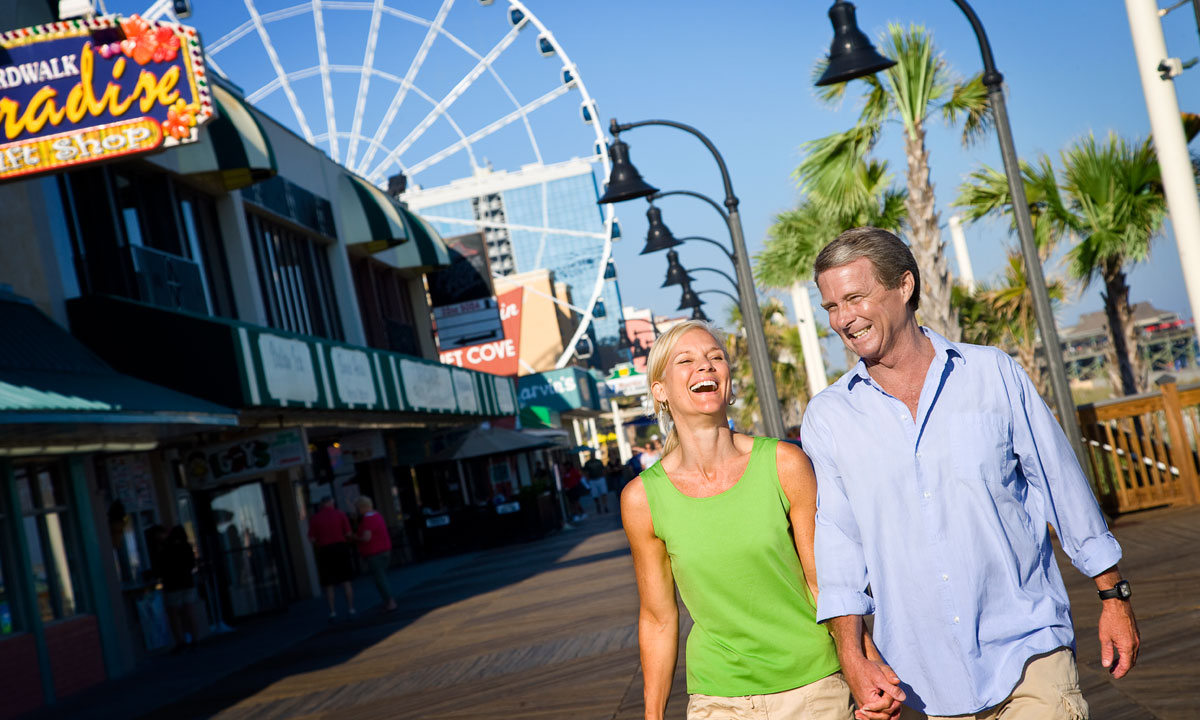 couple strolling the myrtle beach boardwalk