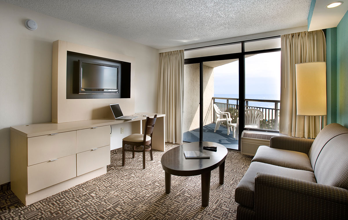 hotel suite living room at captain's quarters resort