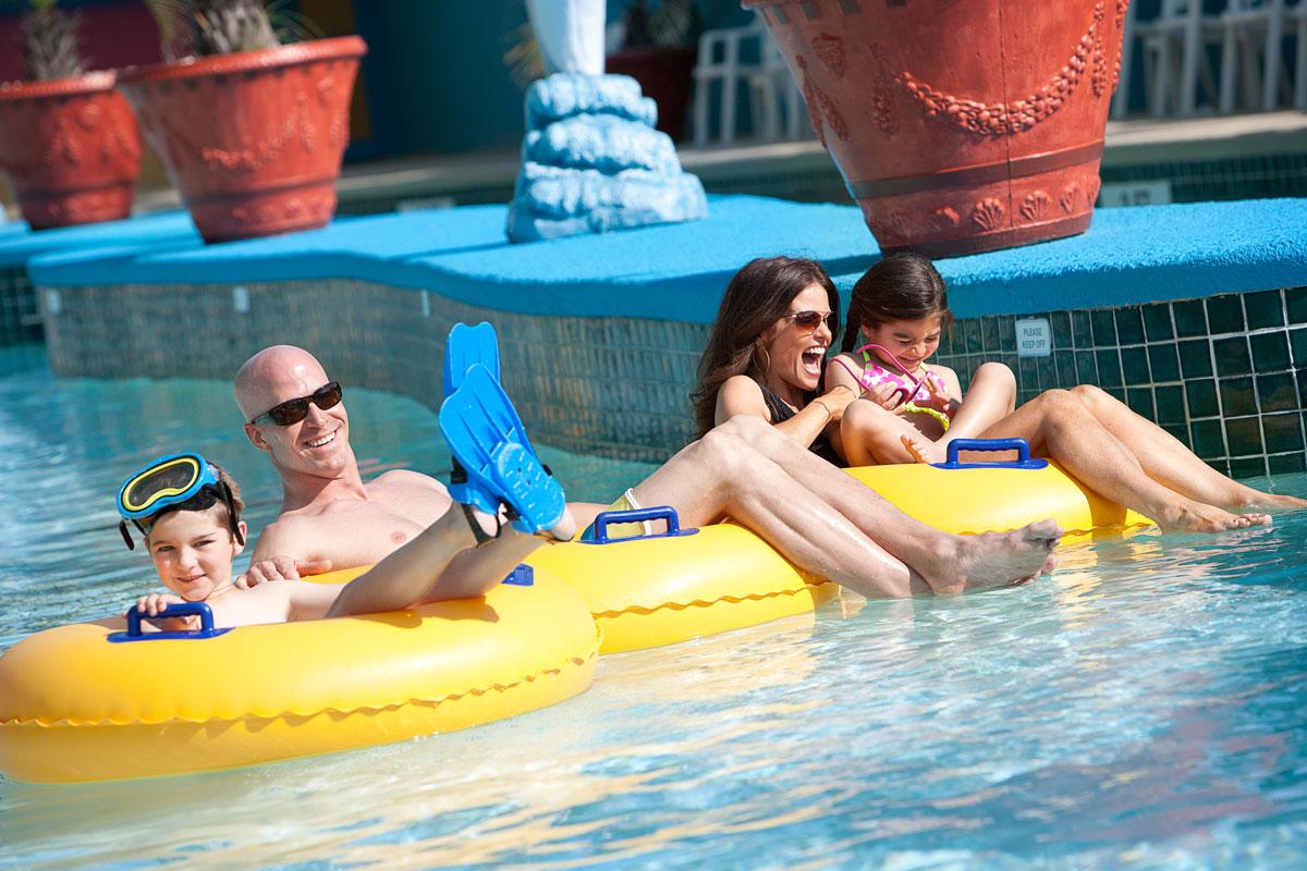 family in the landmark resort lazy river