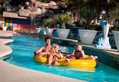 family in lazy river at landmark resort
