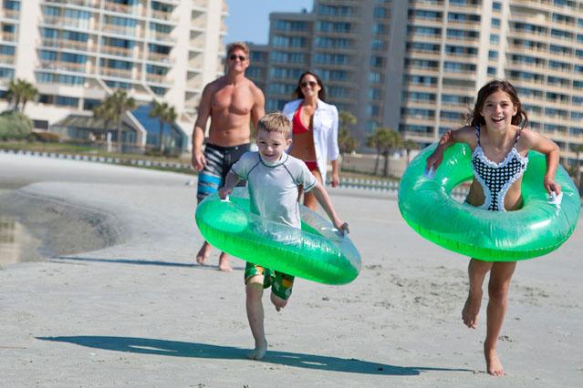 kids running on the secluded ocean creek resort beachfront