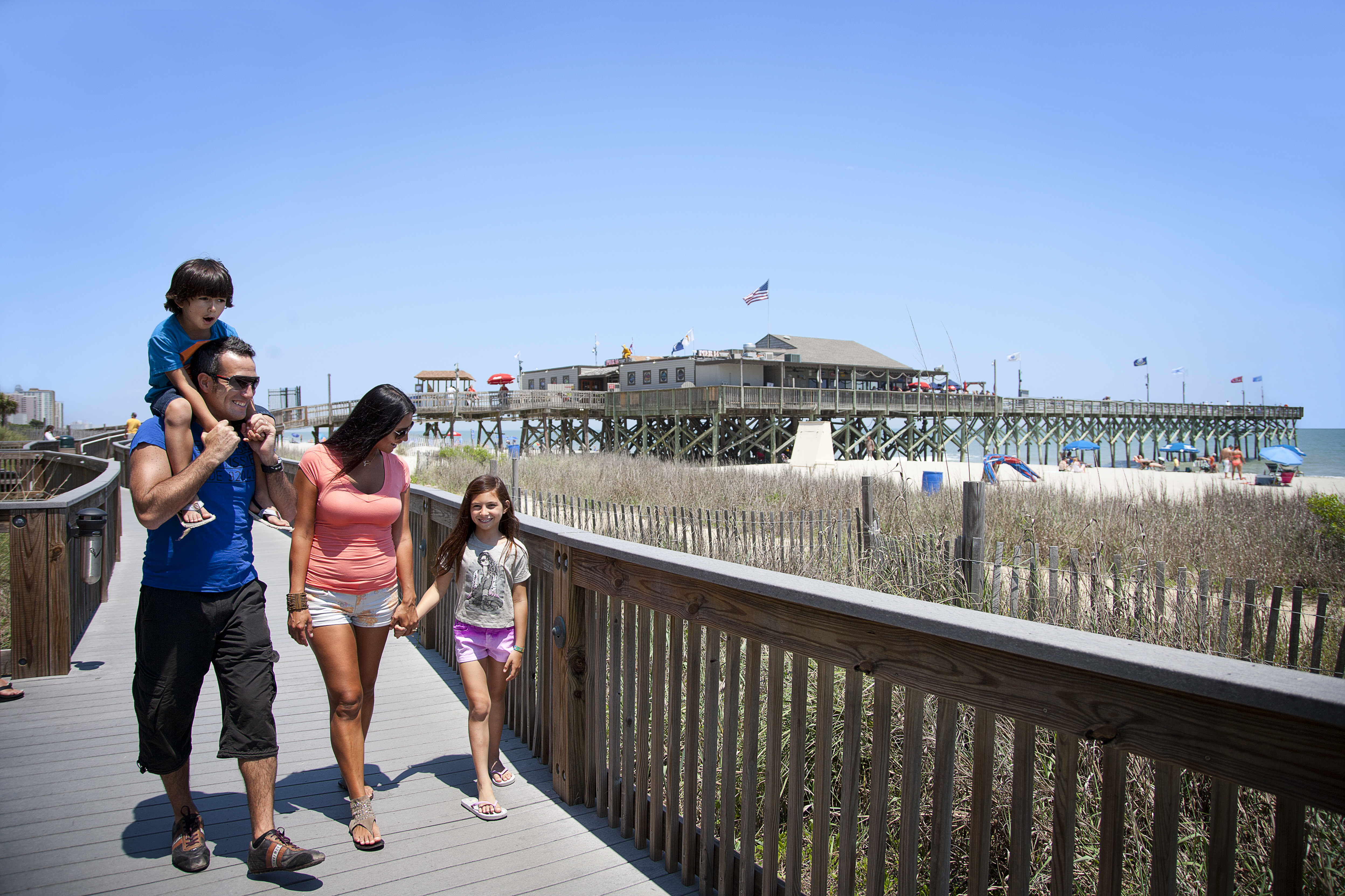 Family walking on the boardwalk Myrtle Beach