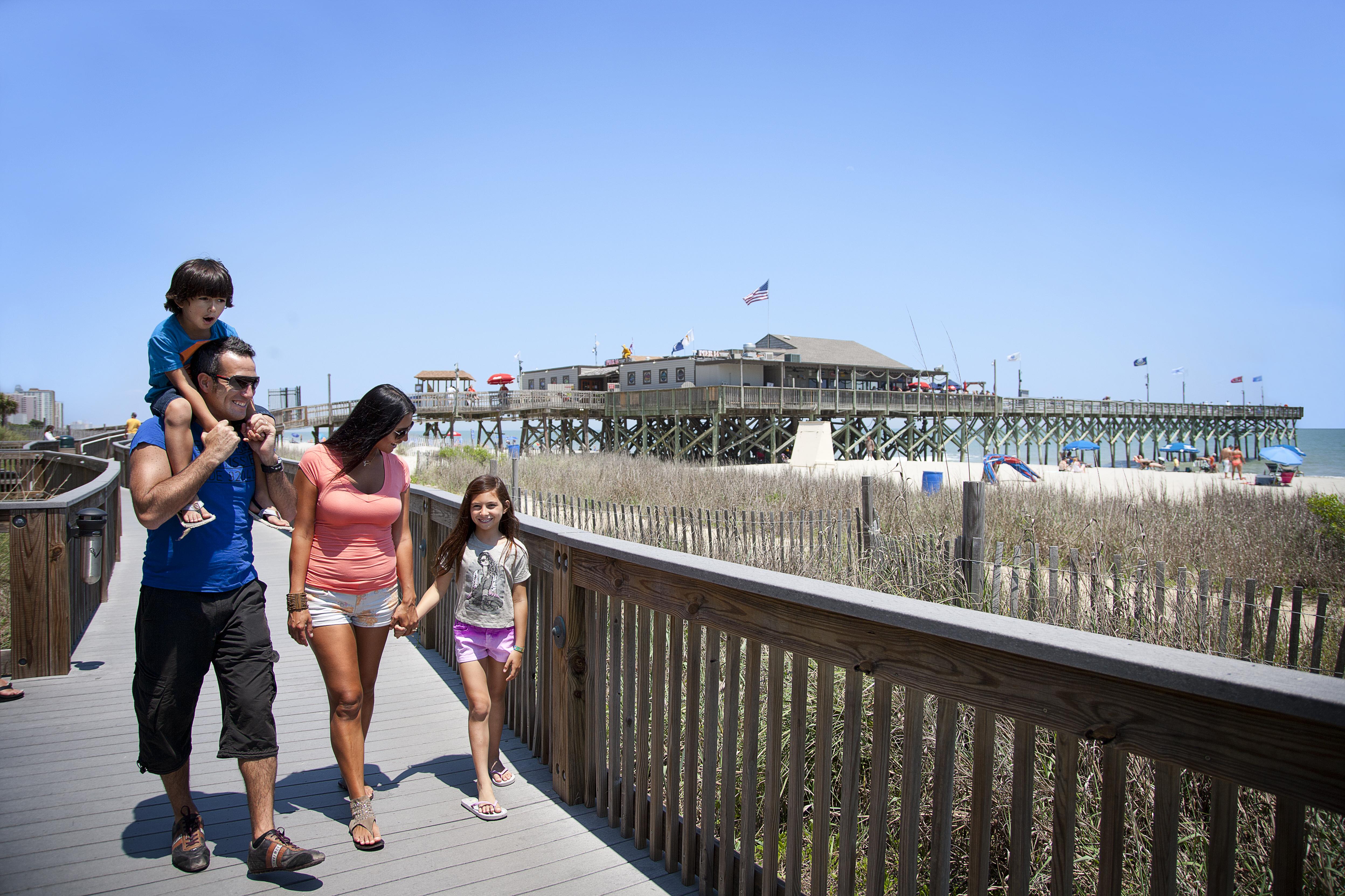 Family walking on the boardwalk Myrtle Beach