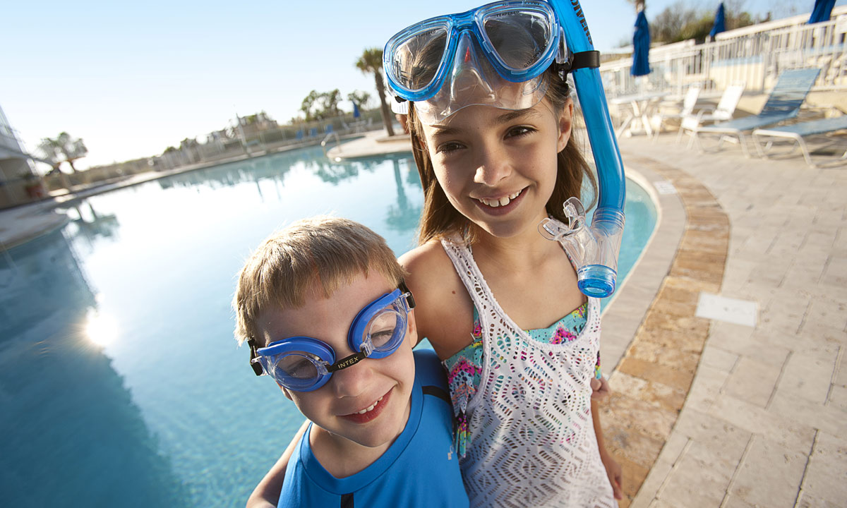 kids enjoying the pool at Sea Watch Resort, one of the top kid-friendly hotels in myrtle beach
