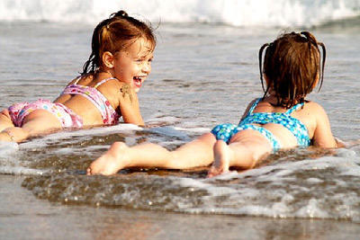 kids playing in the waves in myrtle beach