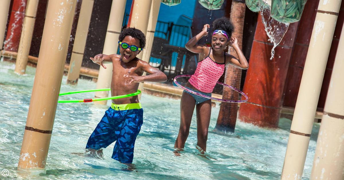 kids having fun at the h2oasis waterpark at landmark resort